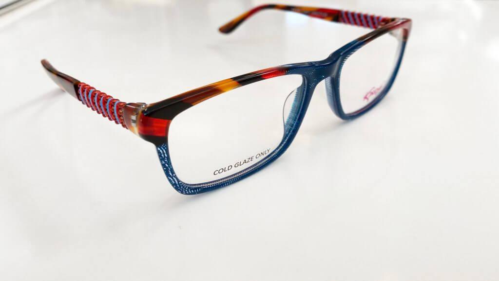Brille kaufen - blaue Brille mit rot-gelbem Rand